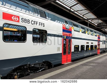Zurich, Switzerland - 1 February, 2015: a passenger train at a platform of the Zurich main railway station. Zurich main railway station is the largest railway station in Switzerland.