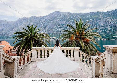 Bride In Wedding Dress In Beautiful Location