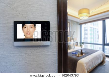 intercom video door bell on the wall outside modern bedroom