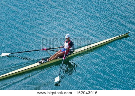 Single scull rowing competitor, toned image, horizontal