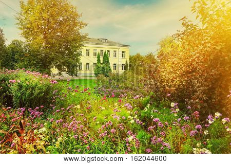 Landscape With Flowers Trees And Building