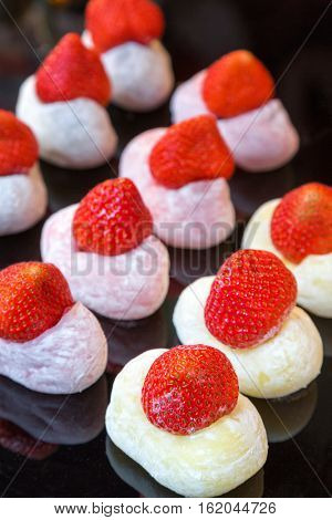Fresh strawberry mochi for sale at a Tokyo street market. Mochi is a japonica rice based dessert, enjoyed all year round but particularly at Japanese New Year and ceremonial holidays