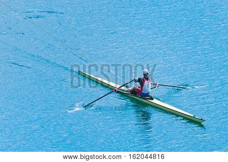Sport rowing single scull, toned image, horizontal