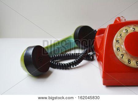 tube old landline phone on white background