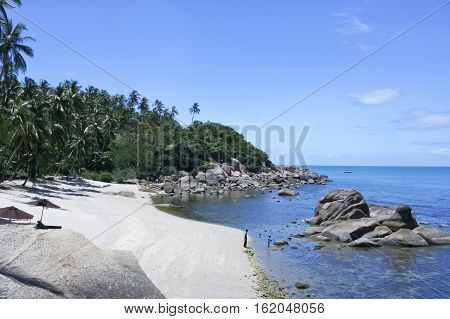 small hidden beach surrounded with palm trees lamai koh samui island in the gulf of thailand