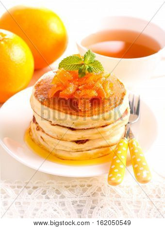 Orange pancakes with candied zest on top