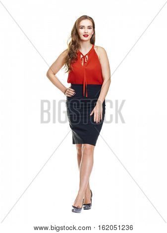 Young brunette woman in black skirt and red blouse, isolated on white background