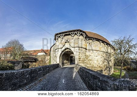 View At The City Gate And Of A Little Wooden Bridge Of The Medieval City Of Rothenburg Ob Der Tauber