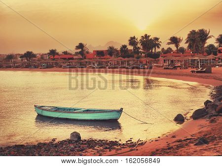 tropical beach with lonely boat landscape photo