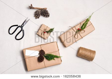 Christmas Presents. Packages Wrapped In Kraft Paper Tied With Jute And  Label To Copy Space