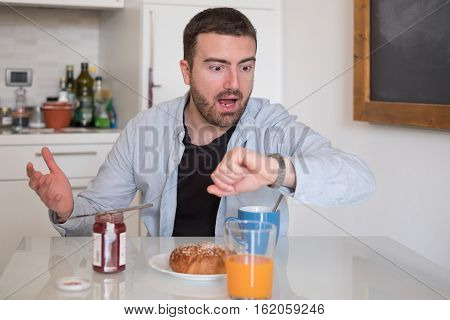 Man Having Breakfast But Too Late To Go To Job