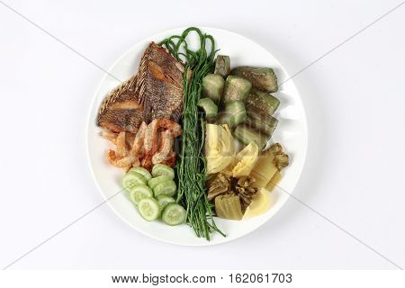 Ready Side Dish With Fired Tipalia Fish And Mixed Vegetable.