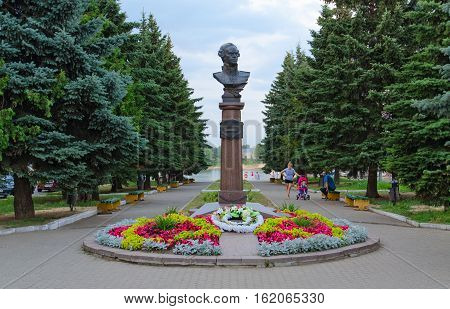 RYBINSK RUSSIA - JULY 21 2016: Monument to Admiral Ushakov in Rybinsk. Unidentified people walk along alley in park