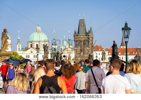 PRAGUE CZECH REPUBLIC - SEPTEMBER 07 2016: Bustling crowd at Charles Bridge (Karluv most) facing the old town.