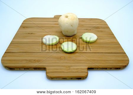 Fresh Turnip Whole And Sliced On A Wooden Kitchen Board.
