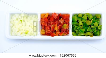Red And Green Pepper And Onion Cut Into Dice In A Bowl