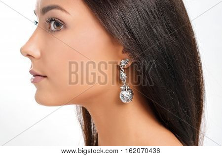 young european model with earring. Close-up portrait