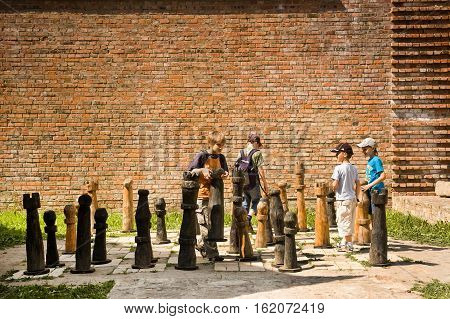 Lutsk Ukraine - June 01 2011: Childrens enjoying a game of chess at High Castle. Lutsk High Castle began its life in the mid-14th century as the fortified seat of Gediminas' son Lubart