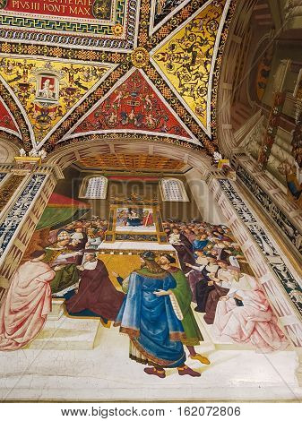 SIENA, ITALY - SEPTEMBER 21, 2016: Interior of Duomo di Siena or Siena Cathedral. Piccolomini Library with frescoes painted by Umbrian Bernardino di Betto called Pinturicchio