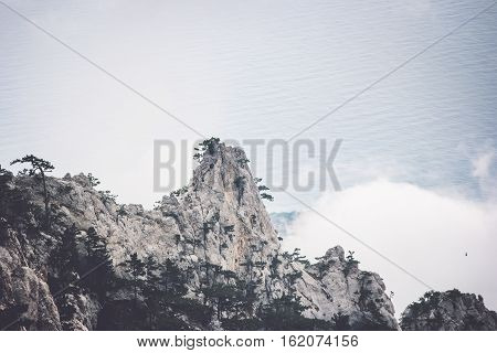 Foggy rocky Mountains and sea Landscape Travel serene scenic aerial view moody weather