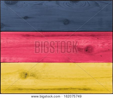 Timber planks of wood that have been painted or stained in the colors of a flag as a background for Germany