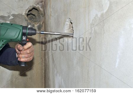 Chiseling A Hole In A Wall