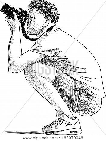 Vector drawing of a crouching man taking picture.
