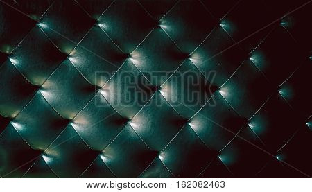 Greenish dark color of  leather sofa texture background