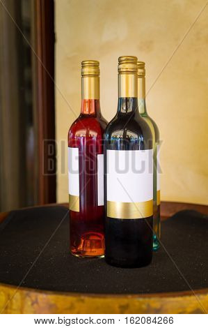 Three bottle grape wine which are to be presented as gift to  people.