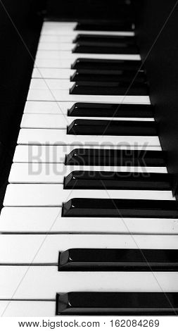 Piano keys,  musical instrument,  piano keys on black background,  black and white