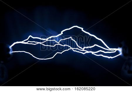 This artificially created by an spark discharge in the air. Is used to observe the phenomenon.