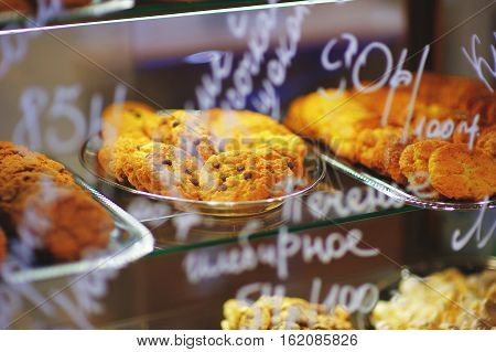 Showcase pastry shop with delicious shortbread with raisins on a tray closeup.
