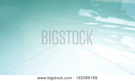 Blur background leaf shadow turquoise color on the poly plastic sheets white color.