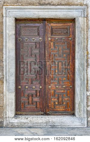 A close up view of some doors at the blue mosque in the turkish city of Istanbul.
