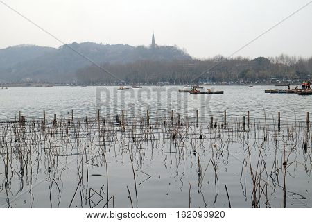 HANGZHOU - FEBRUARY 21: People are moving in boats on West lake in Hangzhou, China, February 21, 2016.