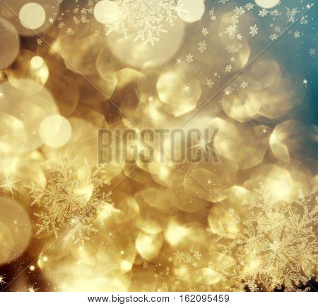 Magic golden holiday abstract glitter background with blinking stars and falling snowflakes. Blurred bokeh of Christmas lights.