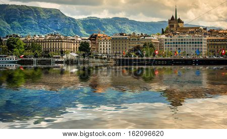 Geneve, Switzerland - 11 May 2014: panoramic view of the modern embankment and the center of Geneva with reflection in water, Switzerland