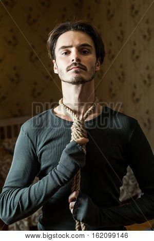 Desperate man hold a noose around his neck.