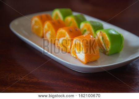 slice roll cake arrangement on white plate