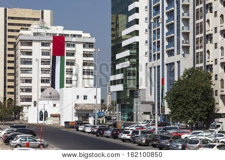 ABU DHABI UAE - NOV 24 2016: National flag of the United Arab Emirates on a building in the city of Abu Dhabi at the UAE National Day Celebrations