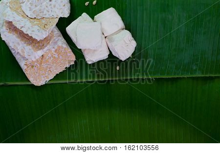 closeup soybean tempeh and tofu in banana leaves, food from Indonesia