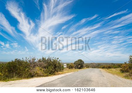 Road to nowhere with blue sky and dramatic cloudy