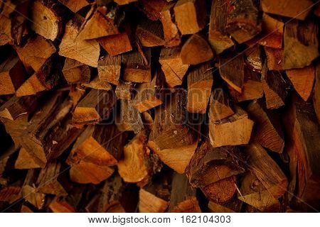wall firewood Background of dry chopped logs in a pile