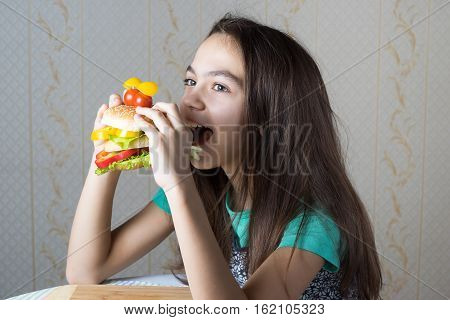 11 Year Old Girl Eating A Hamburger, Side View