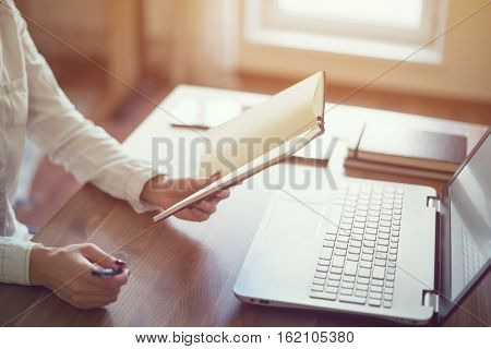 Woman freelancer working at home telework taking notes