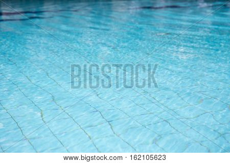 clean and clear water in blue swimming pool texture and background