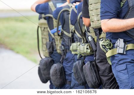 law enforcement training team with tactical equipment and tactical movement in academy