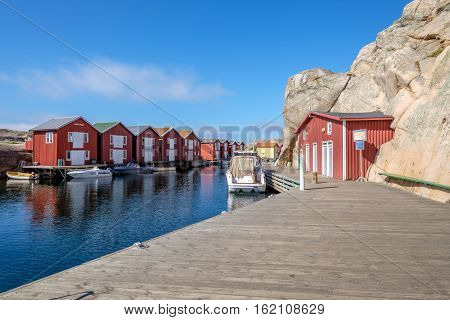 SMOGEN, SWEDEN - SEPTEMBER 3, 2016: The famous boardwalk off-season in Smogen. Smogen is one of the most popular tourist destinations on the Swedish west coast.