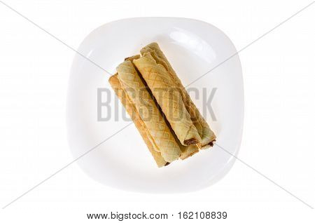 confection rolls with cooked condensed milk on a white background
