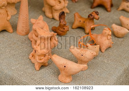 foxes and chickens out of clay. Funny amimals figures